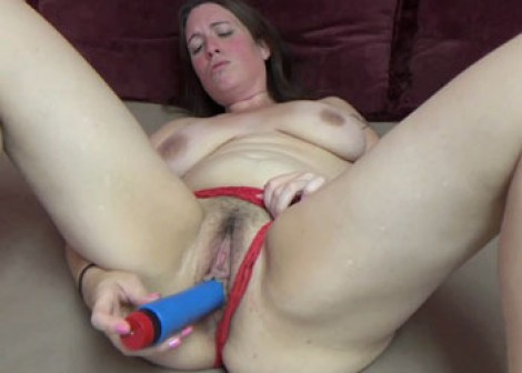 Morgan fucks her plump pussy with a toy